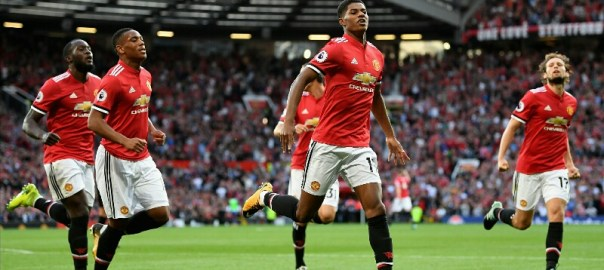 Marcus Rashford celebrates with team after scoring a goal in one of their recent matches.