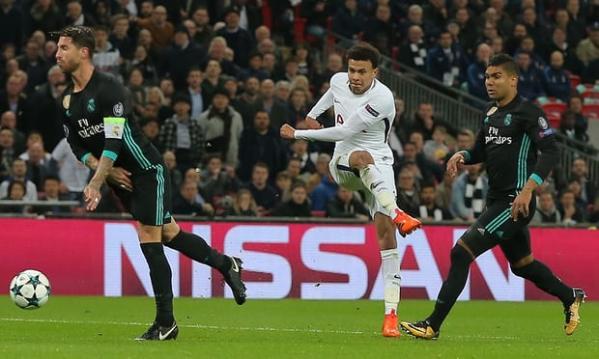 Dele Alli of Tottenham Hotspur scores his side's second goal via a big deflection off Sergio Ramos, left. Photograph: Michael Zemanek/BPI/Rex/Shutterstock