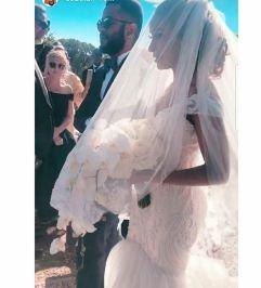 The bride, Adesua Etomi being led down the aisle