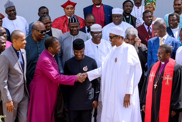 President Muhammadu Buhari and President of CAN, Sampson Ayokunle shaking hands