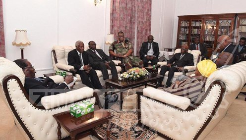 Latest images from Harare: President Mugabe meets ZDF Commander General Constantino Chiwenga, Father Fidelis Mukonori and South African envoys at State House this afternoon. [Photo Credit: herald.co.zw]