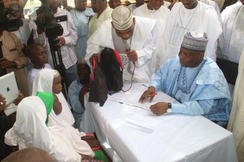 Governor Aminu Waziri Tambuwal enrolling new intakes into primary school at the flag-off of Sokoto state school enrollment drive in Riji, Rabah LGA.