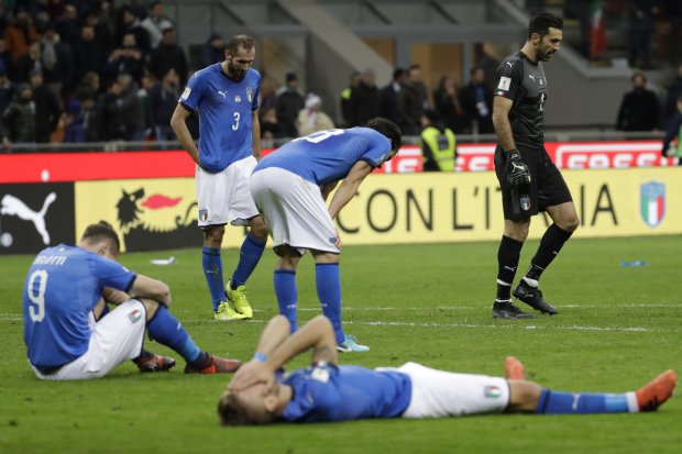 Italian players react to their elimination at the end of the World Cup qualifying play-off second leg soccer match between Italy and Sweden, at the Milan San Siro stadium, Italy, Monday, Nov. 13, 2017. (AP Photo/Luca Bruno)