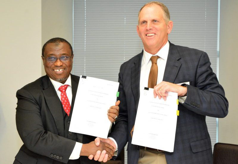 GMD NNPC, Maikanti Baru (L) with MD, Chevron Nigeria Ltd, Jeff Ewing shortly after signing an Alternative Financing Agreement to fund the Phase II of the NNPC/CNL Joint Venture (Project Falcon, in London, at the weekend.
