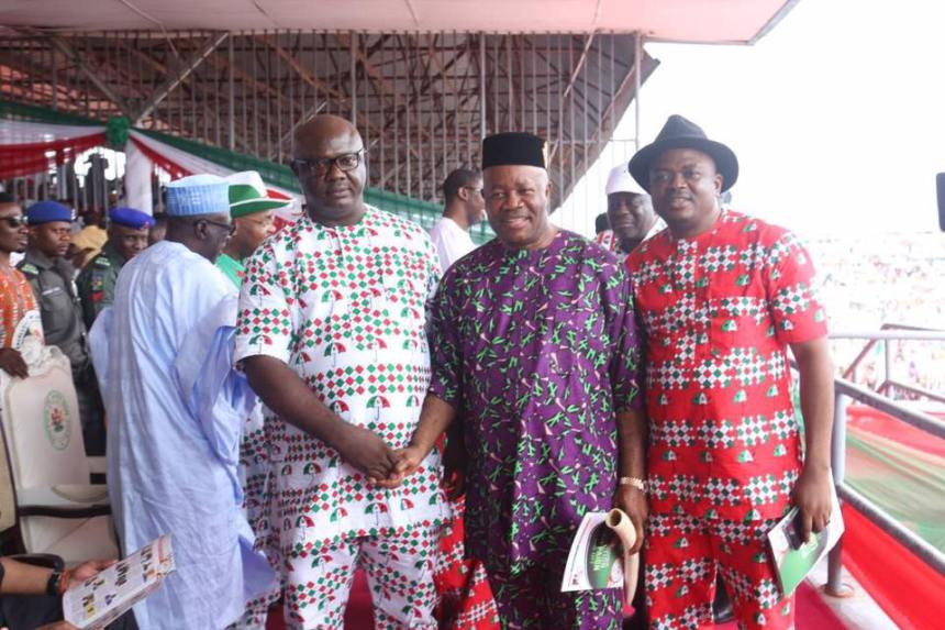 Senator Godswill Akpabio flanked by Mr. Samuel Effanga (R) and Sunny Elijah (L), two APC members in Akwa Ibom State who recently defected to PDP