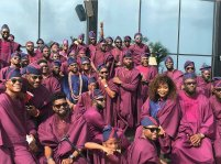A crowded photo of Banky W with friends