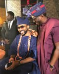 Banky W laughs as Bovi talks to him