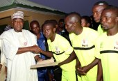 Speaker, House of Representatives, Rt. Hon. Yakubu Dogara congratulating the Winning Team at the finals of Dogara Unity Cup Football Competition sponsored by him in Bogoro LGA, Bauchi State, with them is Mr. Douglas Balarabe on Friday 29th December,2017.