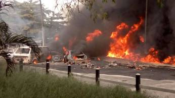 Scene of the incident and cars being burnt