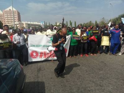 Protesters Storm National Assembly over NGO bill [Photo: Kemi Busari - PREMIUM TIMES)