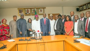 Hon. Minister of Power, Works & Housing, Mr Babatunde Fashola,SAN(6th left), Minister of State, Hon.Mustapha Baba Shehuri(3rd left),Governor of Lagos State, Mr Akinwunmi Ambode(5th left),Secretary to the Lagos State Government, Mr Tunji Bello (2nd left), Director, Finance and Accounts of the Ministry,Mr Ibrahim Tumsah,(4th right), Director, Human Resources, Mrs Motunrayo Alimi,(left), Director, Legal Services, Mrs Justina Shuwa (4th left), Lagos State Commissioner for Information and Strategy,Mr Steve Ayorinde (5th right) and others in a group photograph shortly after the Formal Handing Over of the Presidential Lodge, Marina, Lagos, to the Government of Lagos State at the Ministry of Power, Works & Housing Headquarters, Mabushi, Abuja, on Tuesday 12th, December 2017.