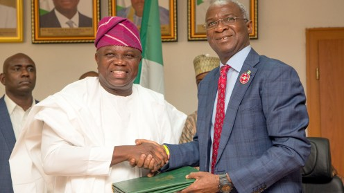 Hon.Minister of Power, Works & Housing, Mr Babatunde Fashola,SAN(right) and Governor of Lagos State, Mr Akinwunmi Ambode(left) during the Formal Handing Over of the Presidential Lodge, Marina, Lagos to the Government of Lagos State at the Ministry of Power, Works & Housing Headquarters, Mabushi, Abuja, on Tuesday 12th, December 2017.