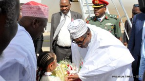 President Muhammadu Buhari (r) receiving a Bouque of Flower from a little girl at the Aminu Kano International Airport during his 2-Day State Visit to Kano on Wednesday (6/12/17) 06554/6/12/2017/Callistus Ewelike/NAN