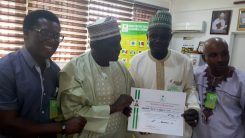 Party members receiving certificate issued by INEC. [Photo credit: Independence Newspaper]