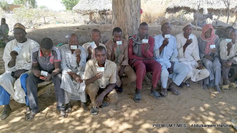Residents of Shuwari-Tomri displaying their past & present voter cards