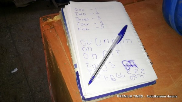 A notebook and pen obviously abandoned by a fleeing student