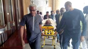 A former spokesperson of the Peoples Democratic Party, Olisa Metuh, arrived the Federal High Court, Abuja, venue of his ongoing corruption trial on a stretcher after being taken down from an ambulance