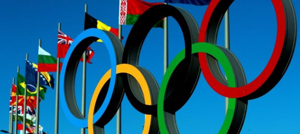 The Olympic Rings stand in front of the flags of Nations in the Olympic Park in Sochi.. Picture date: Monday February 3, 2014. See PA story OLYMPICS Sochi. Photo credit should read: David Davies/PA Wire.