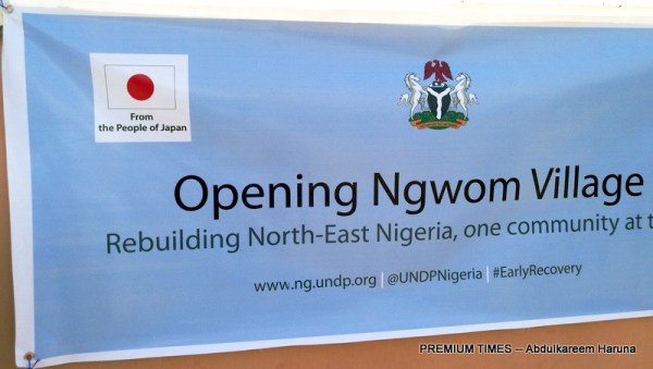 A bill board by UNDP welcoming guests to the opening of newly built Ngwom village