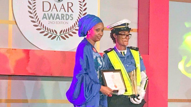 Managing director of the Nigerian Ports Authority, Hadiza Bala Usman presenting award for dedication to traffic policewoman Josephine Okeme.