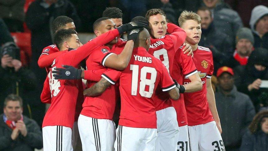 Manchester United celebrates after scoring