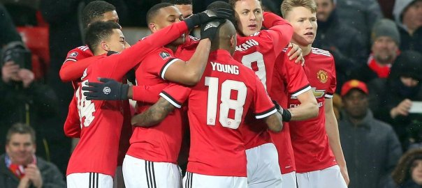 Manchester United celebrates after scoring