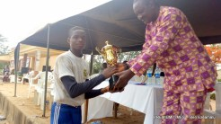 Mba receiving the Trophy on behalf of his team