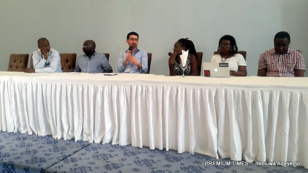 Panel of international media personalities, representatives from Paradigm Initiative answering questions from journalists
