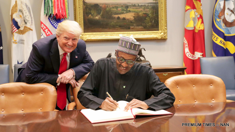 President Donald Trump of United States (l) pose while President Muhammadu Buhari signs visitors book at the White House in Washington DC on Monday (30/4/18) 02254/30/4/2018//ICE/NAN