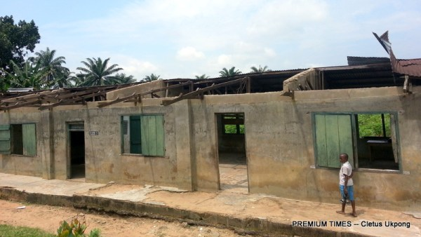 A pupil walked past a dilapidated school building at Annang Peoples Primary School, Ikot Iyire, Ukpom Abak