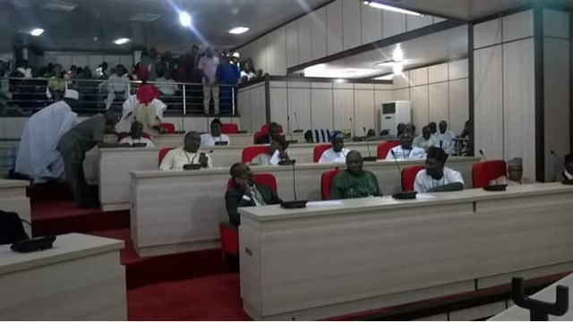 Image result for Benue Assembly members scale fence, suspend ex-speaker Ikyange