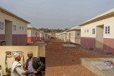 A cross section of the 2-bedroom Semi -Detached Bungalows of the National Housing Programme in Dutse, Jigawa State. INSET: Hon. Minister of Power, Works & Housing, Mr Babatunde Fashola, SAN (left) and Governor of Jigawa State, Alh. Muh'd Badaru Abubakar(right) during a courtesy visit to the State Government House in Dutse, Jigawa State, on Tuesday 8th May 2018.