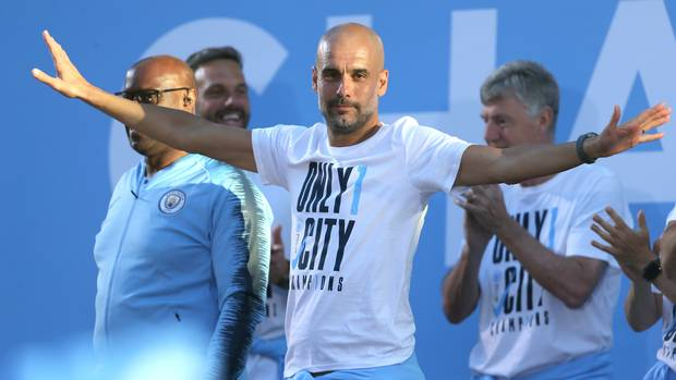 Man City's Pep Guardiola signs contract extension to 2021