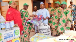 Chairman, Nigeria Labour Congress, Katsina State Chapter, Comrade Tanimu Saulawa, presenting some food items to the Director of a 'Motherless Babies Home', Malam Abdullahi Bala, during the 2018 May Day celebration in Katsina on Tuesday (1/5/18). 02280/1/5/2018 /Ibrahim Bashir/BJO/NAN