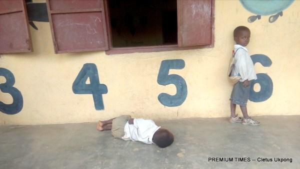 Pupil sleeps on the verandah of a classroom in Ukana Iba, Essien Udim