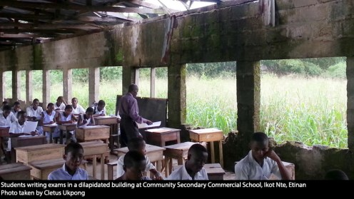 Students writing exams in a dilapidated building at Community Secondary Commercial School, Ikot Nte, Etinan