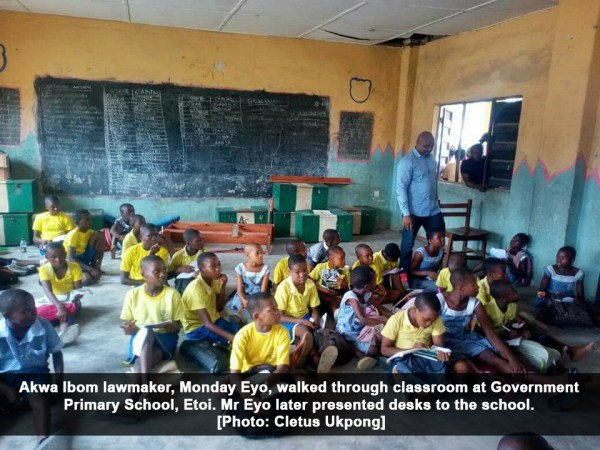 Akwa Ibom lawmaker, Monday Eyo, walked through a classroom at Government Primary School, Etoi. Mr Eyo later presented desks to the school