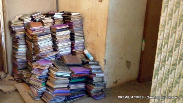 Books littered in the hallway.