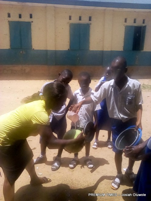 Eva Valley School pupils helping to wash a melon fruit
