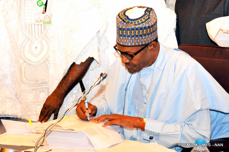 President Muhammadu Buhari signing the 2018 Appriation Bill into law at the Presidential Villa in Abuja on Wednesday (20/6/18) 03267/20/6/2018/Callistus Ewelike/NAN