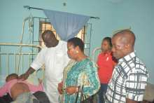 Speaker, Delta State House of Assembly, Sheriff Oborevwori (on white), while visiting Master Chigozie Ogbu in the hospital