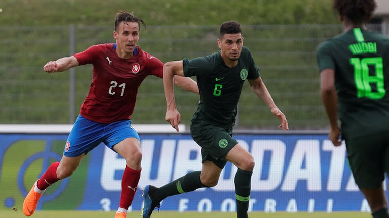 William Troost Ekong slugs it out with a Czech Republic player