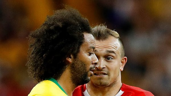 Switzerland Xherden Shaqiri reacts to Brazil's Marcelo (Photo Credit: Reuters)
