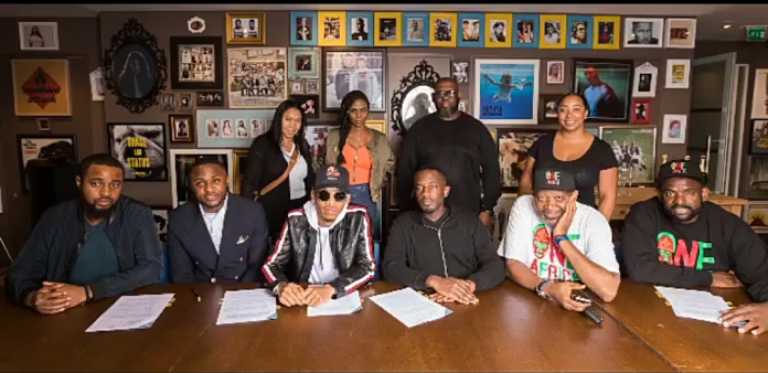 Tekno during his signing with UMG Nigeria