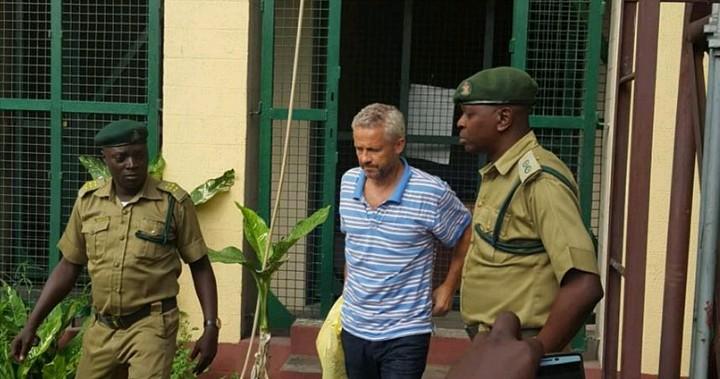 Demark driver accused of killing his Nigerian wife, daughter testifies