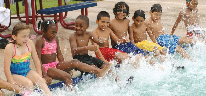 Children playing at the swimming pool used to illustrate the story
