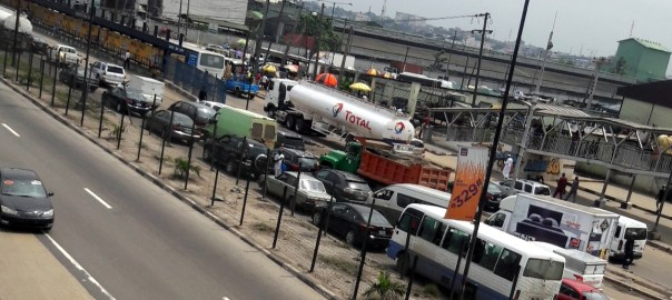 Petrol tankers moving at Ojota, Ikorodu Road, less than 24 hours the government restricted them to the Apapa-Oshodi-Oworonshoki expressway. [Photo by Olamide Fadipe ]