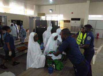 Kogi state pilgrims being screened in preparation for first Hajj 2018 flight at Nnamdi Azikiwe International Airport Abuja. [Photo credit: NAHCON]