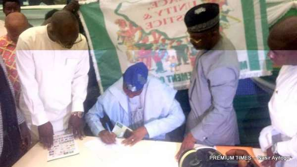 Party leaders signing the MOU