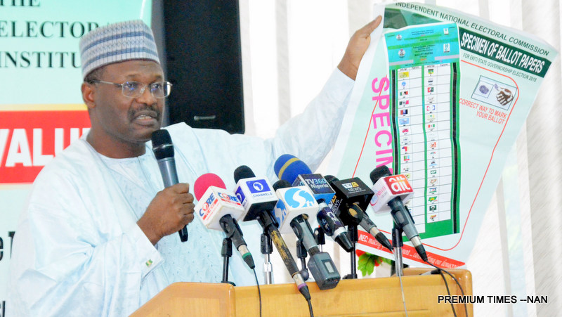Chairman of INEC, Prof. Mahmood Yakubu showing a specimen ballot paper for Ekiti governorship election during the INEC quarterly consultative meeting with political parties, in Abuja on Wednesday (4/6/18). 03573/4/6/2018/Hogan Bassey/NAN
